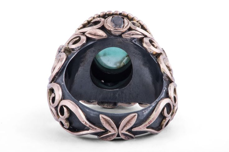 Oval cabochon emerald and natural round, heart and cushion-cut brown diamonds set in oxidized silver and rose gold by GALACIA DESIGNER JEWELRY.
