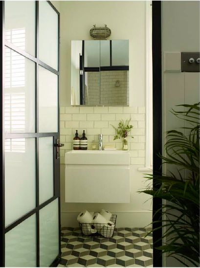 Victorian flat, Fulham. Designed and styled by Imperfect Interiors. www.imperfectinteriors.co.uk Photographs by Rachael Smith  Newly installed bathroom featuring Fired Earth tiles on wallsand floors, internal Crittal windows and doors, Bathstore bath, sink & toilet.