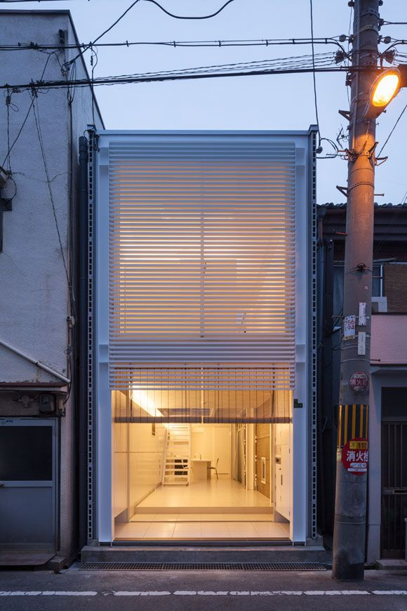 kim house. k associates. osaka, jp.  like a minimalist safe house - i want one of these buried in every major city...