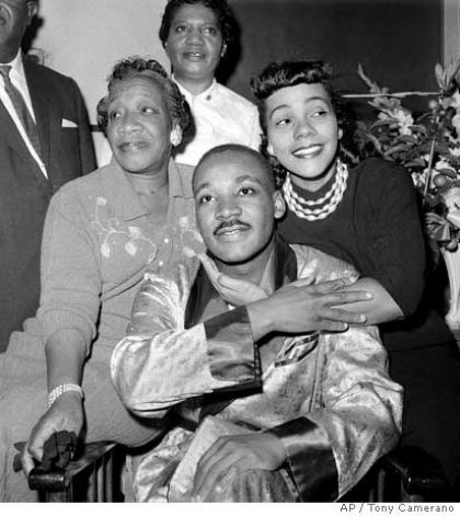 Dr. Martin Luther King, Jr., is embraced by his wife Coretta Scott King during a news conference at Harlem Hospital in New York, in this Sept. 30, 1958 file photo, where he was recovering from a stab wound following an attack by a woman. At left is his mother, Alberta Williams King.