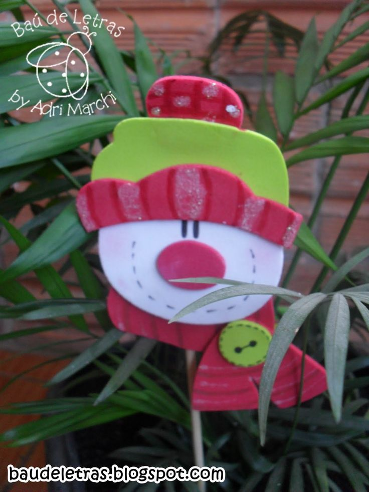 Cute little snowman head ornament/stick...NOT in English