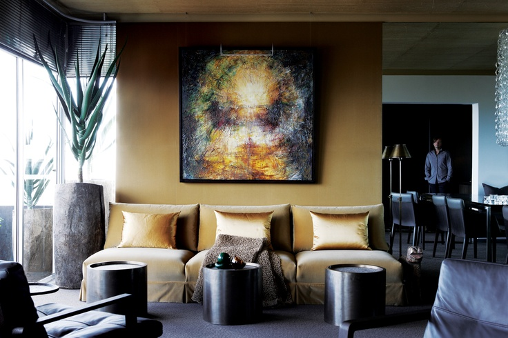 CECILE & BOYD'S DESIGNER, PAUL VAN DEN BERG'S APARTMENT IN CAPE TOWN CAPTURES AN EARTHY GLAMOUR WITH MINERAL-TONED PALETTE AND LUXURY FINISHES.
