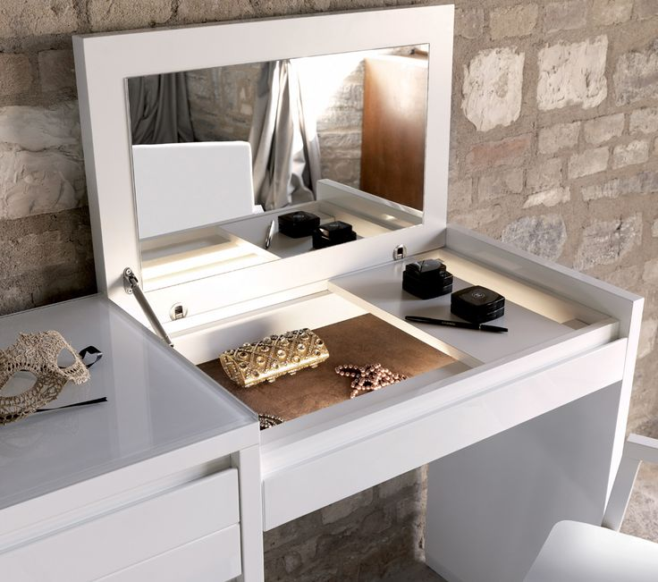 The Adria dressing table from Casabella is a classic contemporary dressing table with a fold down mirror, finished with a glass top.
