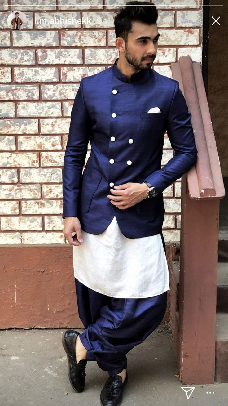 Navy raw silk indowestern. Whatsapp on +919013201999 or mail us on info.baawre@gmail.com for more details.