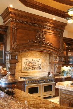 Molding on the hood above the amazing gas stove with Tuscan style backsplash, is very nice.                                                                                                                                                      More