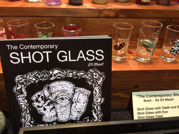 A big beautiful book full of photos of artisan glass shot glasses from all over the world, by Eli Mazet, Mazet Studios