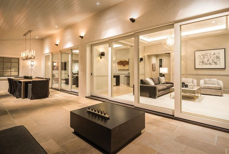 Outdoor living space with large scenic Marvin doors
