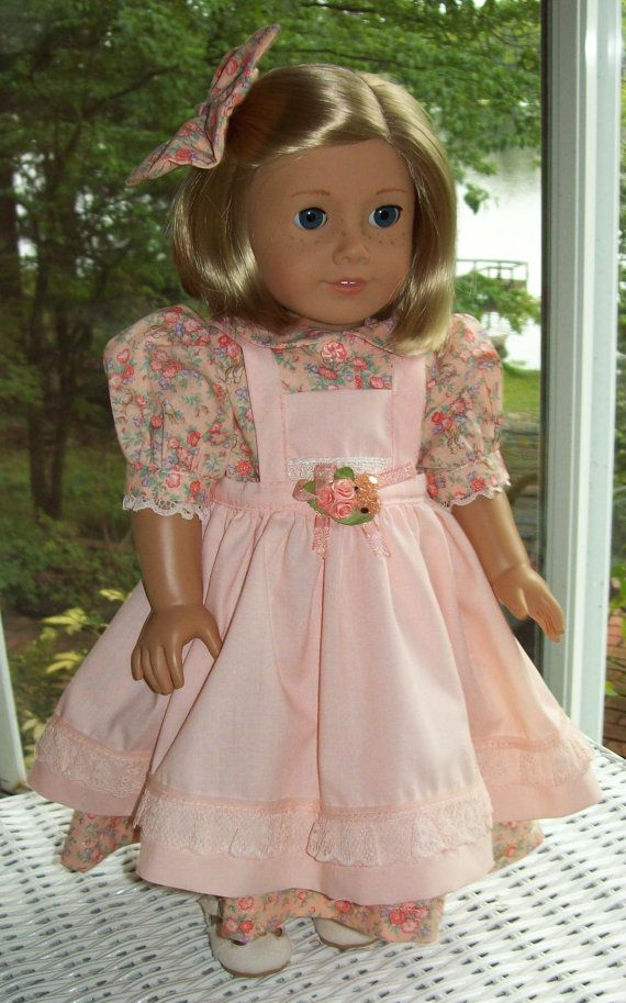 American Girl doll or 18 inch doll dress, hair clip, pinafore, and short leggings. Peach and orange floral print.