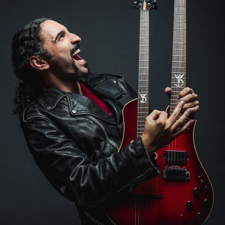 Yossi Sassi from Israel. Plays a signature Bouzouki guitar called a 'Bouzoukitara'. Merging roots with contemporary music, and redefining oriental rock. Constantly exploring the sound and musical boundaries. Drives inspiration from different cultures around the world. http://www.yossisassi.com/, https://www.facebook.com/YossiSassi, https://twitter.com/Yossi_Sassi, https://www.youtube.com/user/yossis9 and https://soundcloud.com/yossisassi
