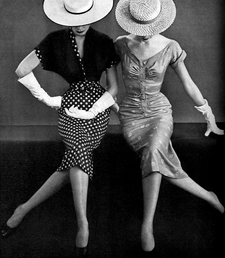 Models in two fitted print dresses by Miss America, Vogue, April 1, 1951