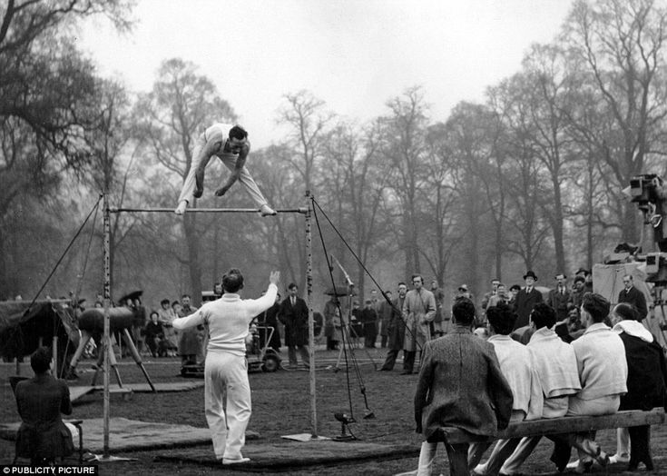 Members of the British gymnastics team practising for 1948 Olympicson the high bar in Hyde Park