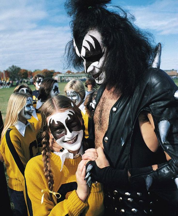 Gene Simmons making friends with head cheerleader Melissa Codden at Cadillac High School when KISS was invited to the Homecoming game (1975).