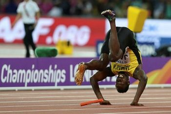 Jamaica's Usain Bolt falls after injuring himself in the final of the men's 4x100m relay athletics event at the 2017 IAAF World Championships at the London Stadium in London on Aug 12, 2017. — AFP