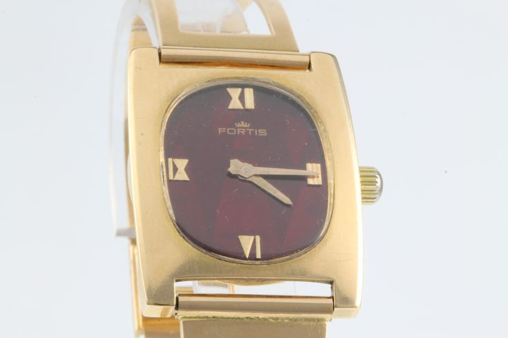 Lot 822, A gentleman's 18ct gold Fortis wristwatch with red dial, 35 grams, having an 18ct gold open bracelet, est  £800-1200