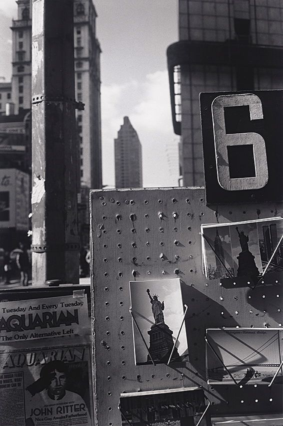 New York City 1980 Photo: Lee Friedlander - glimpses of famous silhouettes between/behind the up close focus of the ordinary - black and white rocks