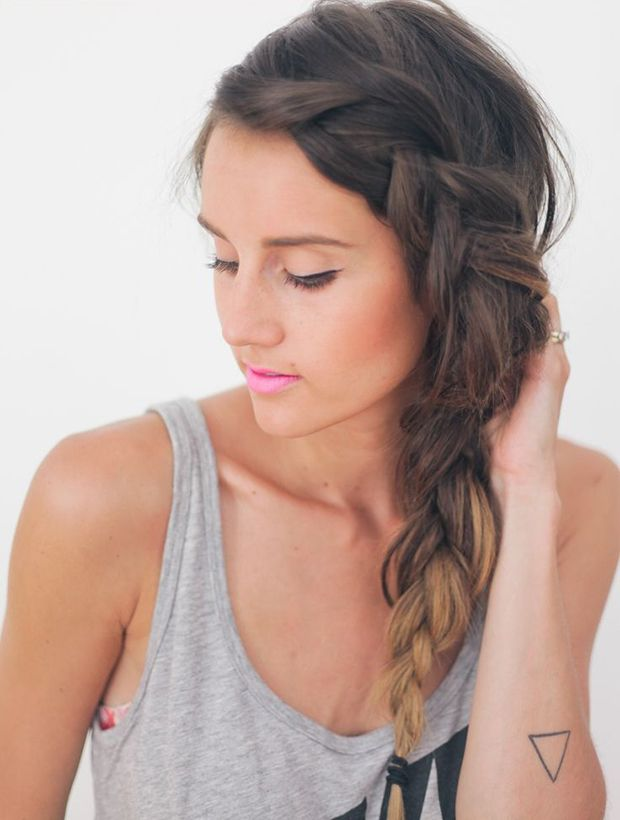 While the casual side braid is always a great option for bad hair days, I love how this look takes it to the next level. To start, you'll want to french braid the front section of hair down to your ear, then continue into a normal braid. If a french braid is too intimidating, just do a regular braid with just the front section of hair. Once you get to your ear, incorporate the braid into the rest of your hair to create the side braid. via @stylelist