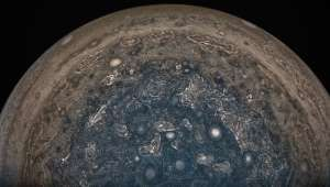 The latest NASA images of Jupiter reveal giant, white storms in its turbulent south pole - Business Insider Inc