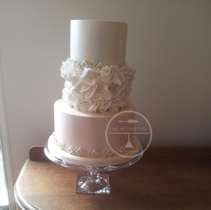 Classic scrunch rose cake with pearl lustre and pretty crystal trim.