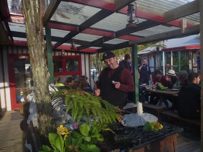 Ben showing of his cooking skills on the BBQ at Glow Worm Cottages in Franz Josef, New Zealand!