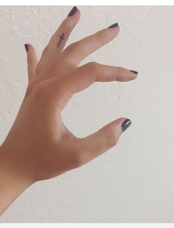 small cross finger tattoo // †