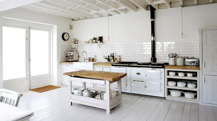 """White kitchen with woodblock counters. Small subway tile + open shelving. Idea for """"empty"""" wall in kitchen."""