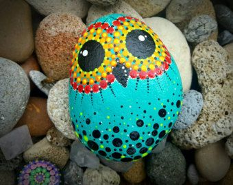 Painted Wisdom Owl on natural Pebbles -The Eco nature way for art  My painted rocks and pebbles are full of happiness and joy, they love to travel around the world and spread colors to every home they arrives.  This painted mandala is made on natural pebble stone with colorfull desigh with acrilic. After I paint the pebbles I apply varnish cover. this pebble stone decor is made with a lot of love to nature. It has owl design on it.  sizes: 3 inch X 2/5 inch  I love to make my art with th...