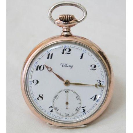 Reloj de bolsillo, antiguo, de plata con carga manual y funcionando, años 1930.