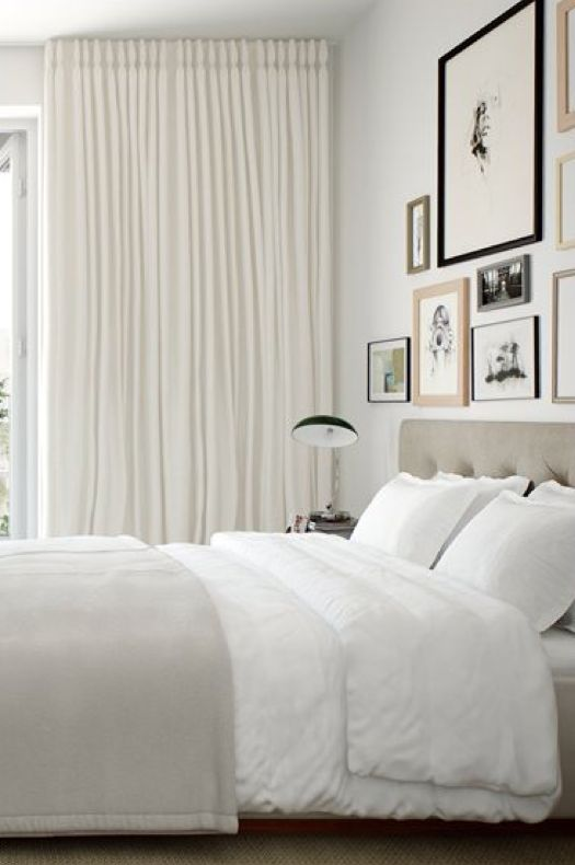 Simple, clean art arrangement with soft drapes in bedroom