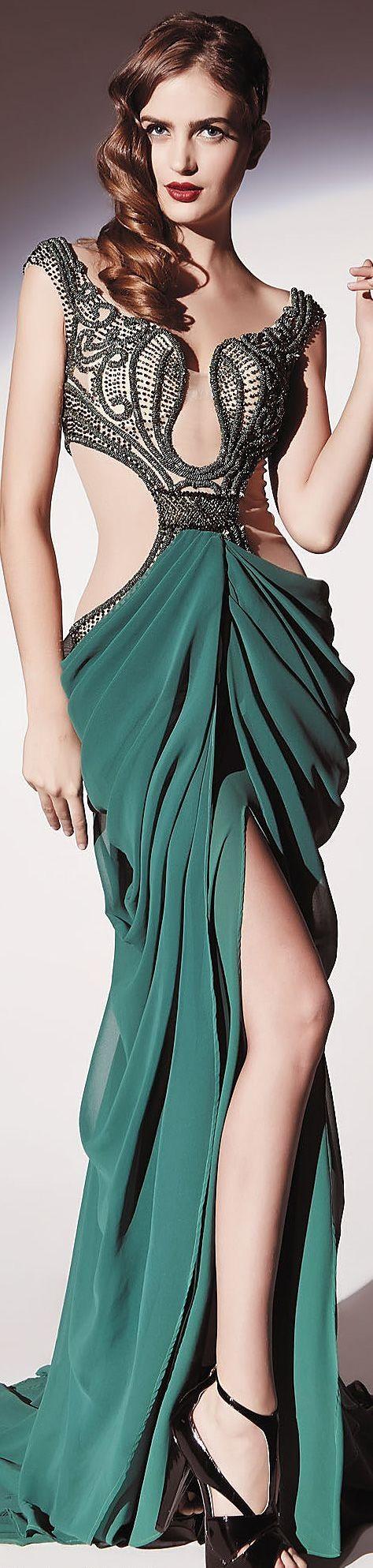 Ideia interessante, gosto da disposição do bordado e do drama na saia. só a confecção que não está muuuuuuuito perfeita. Dany Tabet  2014