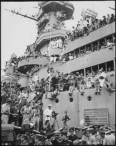 Sailors and others try to get good viewing spots to witness the surrender of Japan USS Missouri