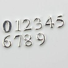 100 unids encantos flotantes números 0-9 encantos flotantes apta que flota medallones de plata encantos número(China (Mainland))