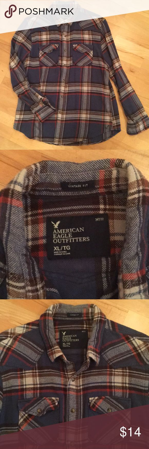 American Eagle Men's Flannel Shirt American Eagle Men's Flannel Button-down Shirt. Blue with brown, white, and burnt orange stripes. Snap buttons. Worn but good condition. American Eagle Outfitters Shirts Casual Button Down Shirts