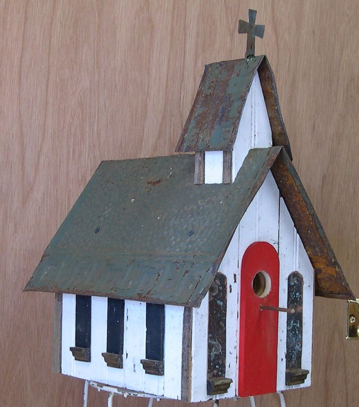 Small country church with red door windows