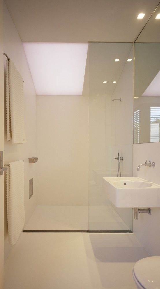 Fink house ian moore architects coins shower trays for Wet room drain