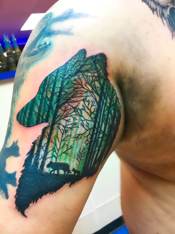 Wolf Tattoo on upper Arm withTree Background. Animal Art, Wildlife tattoo. I am working on a wolf upper sleeve tattoo and looking for ideas for sleeve tattoo additions. Going to put mountain scene behind wolf tattoos.