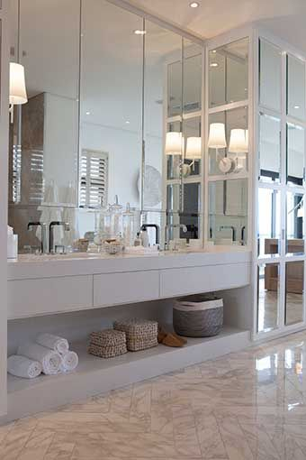 Michele Throssell Interiors Beach house Laid back, casual, comfortable textured interiors Interior design main ensuite bathroom marble herringbone floor foscarini wall light open plan bathroom clean contemporary bathroom grey marble white scheme