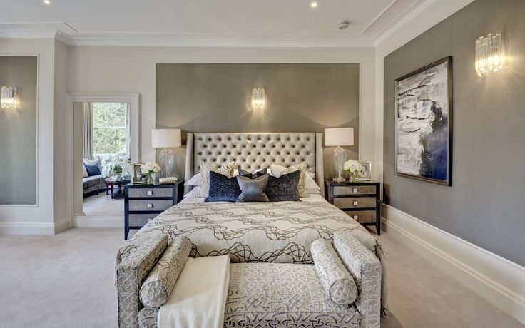 Master bedroom suite of Grade II listed converted Georgian manor house. Elegant eclectic scheme with gold and blue accents designed by www.aji.co.uk