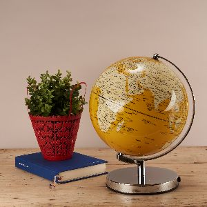 Mustard Yellow Globe Lamp: The world is your oyster with this light up globe. Track where you have been or plan your next big adventure all from the comfort of your home.With a colour palette of mustard yellow and soft cream, this light up globe omits a muted glow, illuminating the worlds continents in style. A fantastic focal feature for both traditional and contemporary interiors.