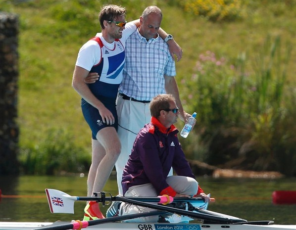 Individual sculling bronze medallist Alan Campbell is helped out of his boat by Sir Steve Redgrave (I was there!)