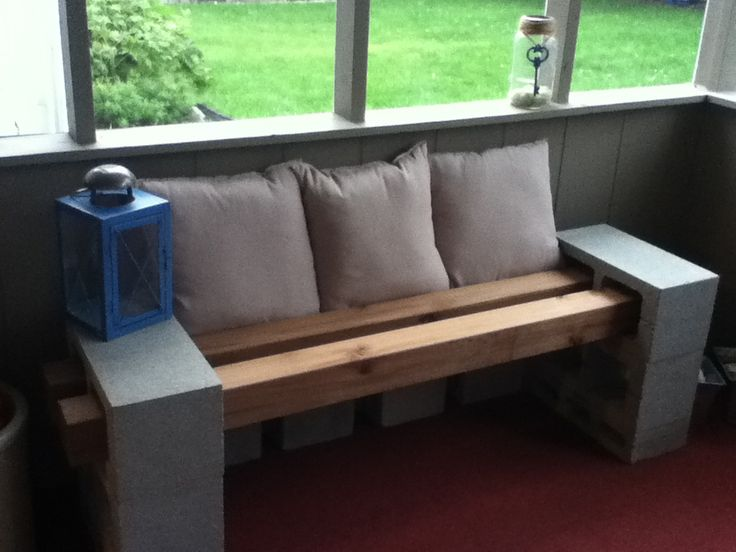 DIY Patio Bench 10 ft Cedar 4x4 cut to 2-5 ft, cement bricks and a few pillows! Love it!