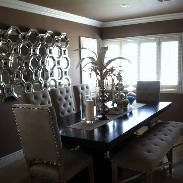 Lisseth loves hosting dinner parties in her chic dining room, styled with Z Gallerie's Montecito Dining Table, Rencourt Side Chairs and Axis Mirror.