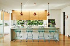 Built by Wilson Gorgeous kitchen with glass window splash back, copper pendants…