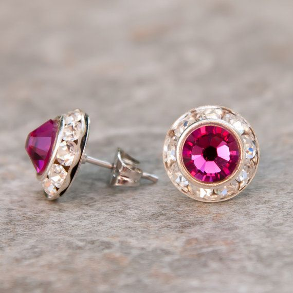 Genuine Swarovski pierced earrings with center stone in your choice of 25 crystal and pearl colors. Available in silvertone or goldtone finish. This listing is for the Mini size, which has a setting that measures 7/16 across. See our other listings for additional sizes. Earrings are made to order -- single sets usually ship in 1-3 days, but if you are placing a large order for multiple sets, please allow 7-10 days. Gift boxed.  IMPORTANT: Computer monitors vary, so actual colors may diff...