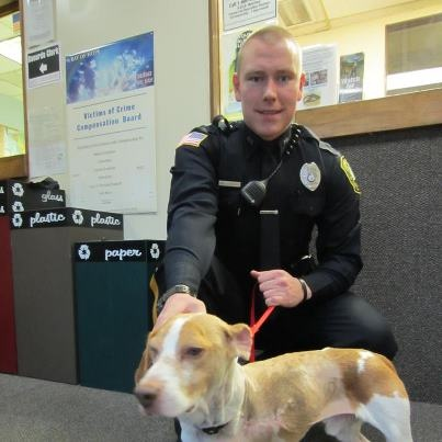 """Yesterday Buddy paid a visit to the Somerville Police Department to personally thank an officer, Josiah, for saving his life. You see, Josiah found Buddy the night of his accident and rushed him to the emergency vet. Please give Josiah and the Somerville police a """"thumbs up"""" for everything they did to help Buddy—and all police officers for the work they do every day to serve our communities! We are incredibly grateful for their service. --Happy Paws Rescue Inc."""