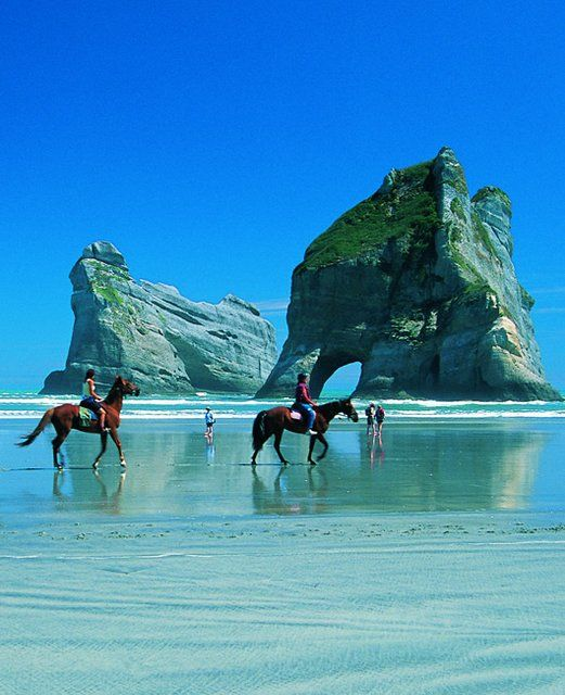Wharariki Beach, New Zealand. Everything at Wharariki is big: big waves, big cliffs, big sand dunes, big caves, and even bigger winds!