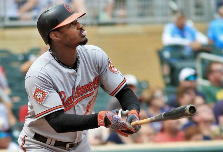 EYES ON THE PRIZE:   Adam Jones of the Orioles watches his sacrifice fly ball against the Twins on July 9 in Minneapolis, Minn. The Orioles won 11-5.