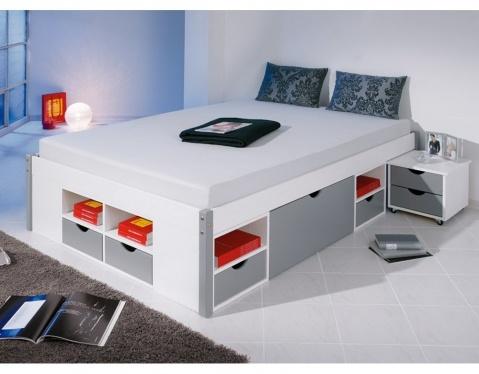 Funktionsbett 140x200 Durchdachtes Funktionsbett mit praktischem Ordnungssystem: 8 Schubladen, 8 Regalfächer und 2 Unterbettkommoden auf Rollen bieten optimalen Stauraum.