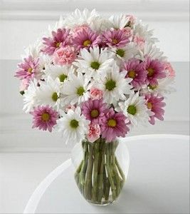 Like this simplistic idea, but with light blue and white daisies for my wedding. :)