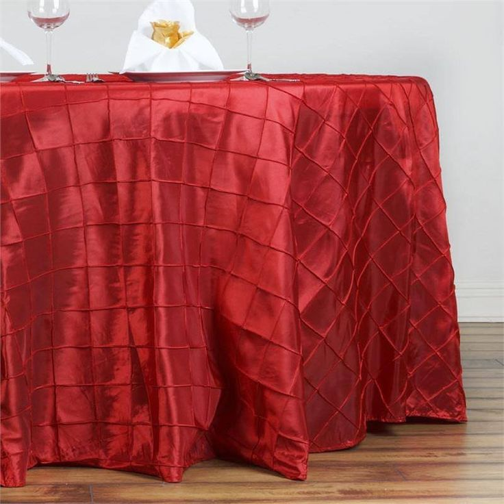 "Red Pintuck Tablecloths 132"" Round - Pintuck is actually a fold of fabric that is stitched intricately to hold it in a place, very much like a pleat. These lovely pleats impart a decorative effect to the fabric by fashioning a visual line at a chosen point. They effortlessly bridge vintage and contemporary styles to create a majestic new classic look. If you do not want your celebration to blend in with other weddings, birthdays, and anniversaries, try our premium quality pintuck Tablecloths…"