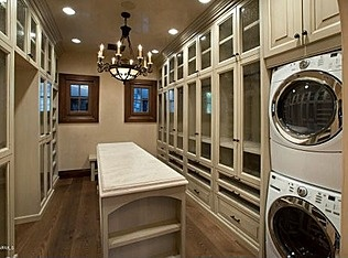 Amazing closet with laundry appliances. What's not to love!